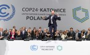 TOPSHOT - COP24 president Michal Kurtyka jumps at the end of the final session of the COP24 summit on climate change in Katowice, southern Poland, on December 15, 2018. (Photo by Janek SKARZYNSKI / AFP) (Photo credit should read JANEK SKARZYNSKI/AFP/Getty Images)
